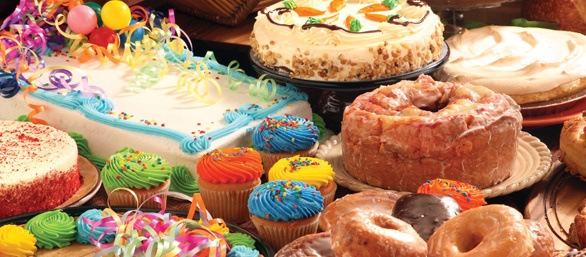 Photo of assorted cakes, donuts and cupcakes.